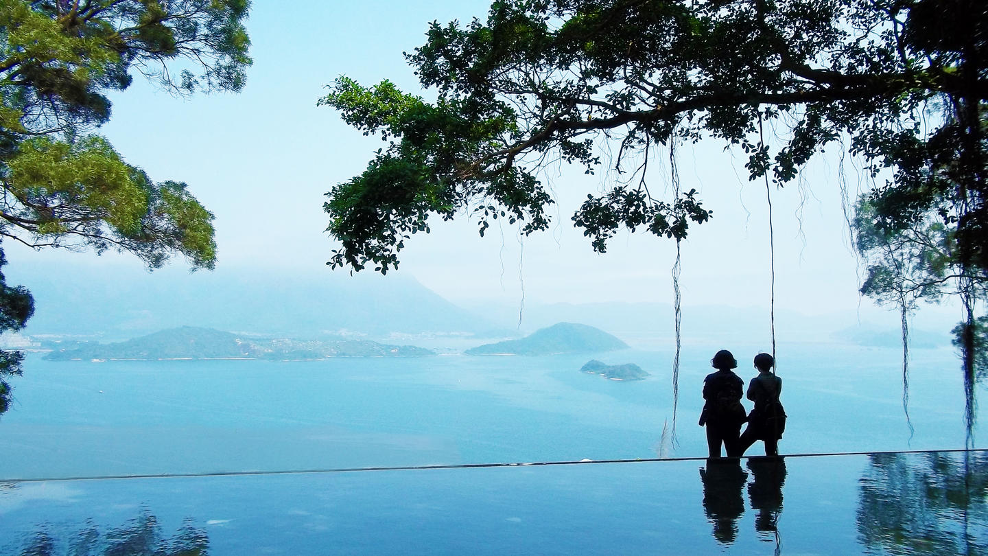 Two people in distance looking at landscape of Hong Kong SAR, China
