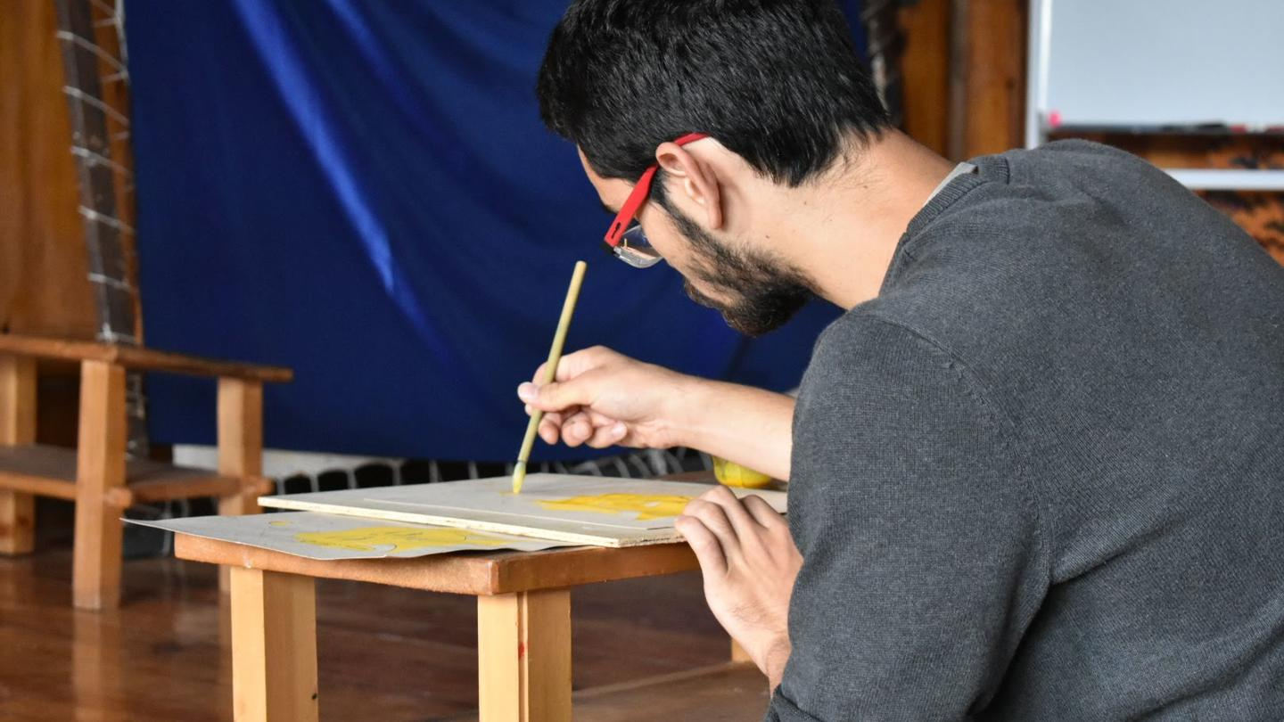 Student painting on a desk in China