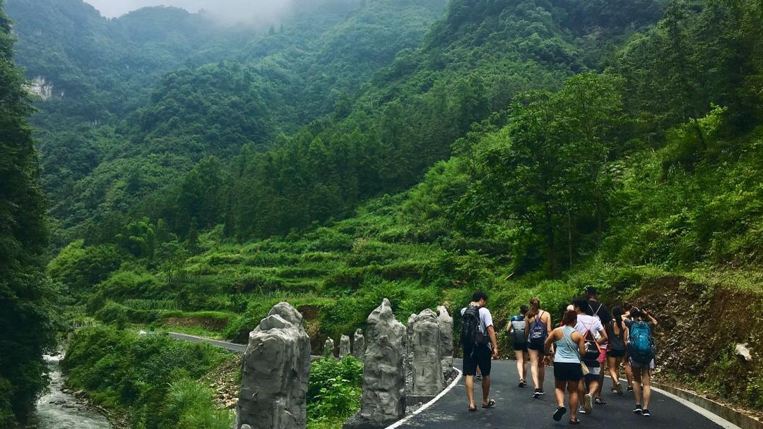 people walking on a trail near mountains in China