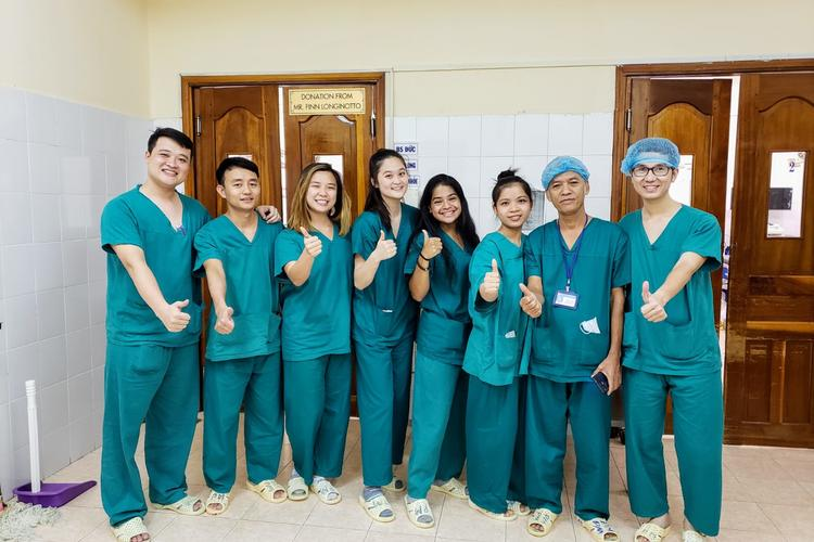 Photo of IIP interns in scrubs