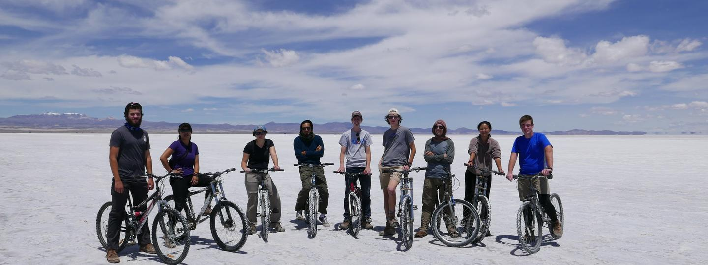 A group of people posing for a picture on bikes