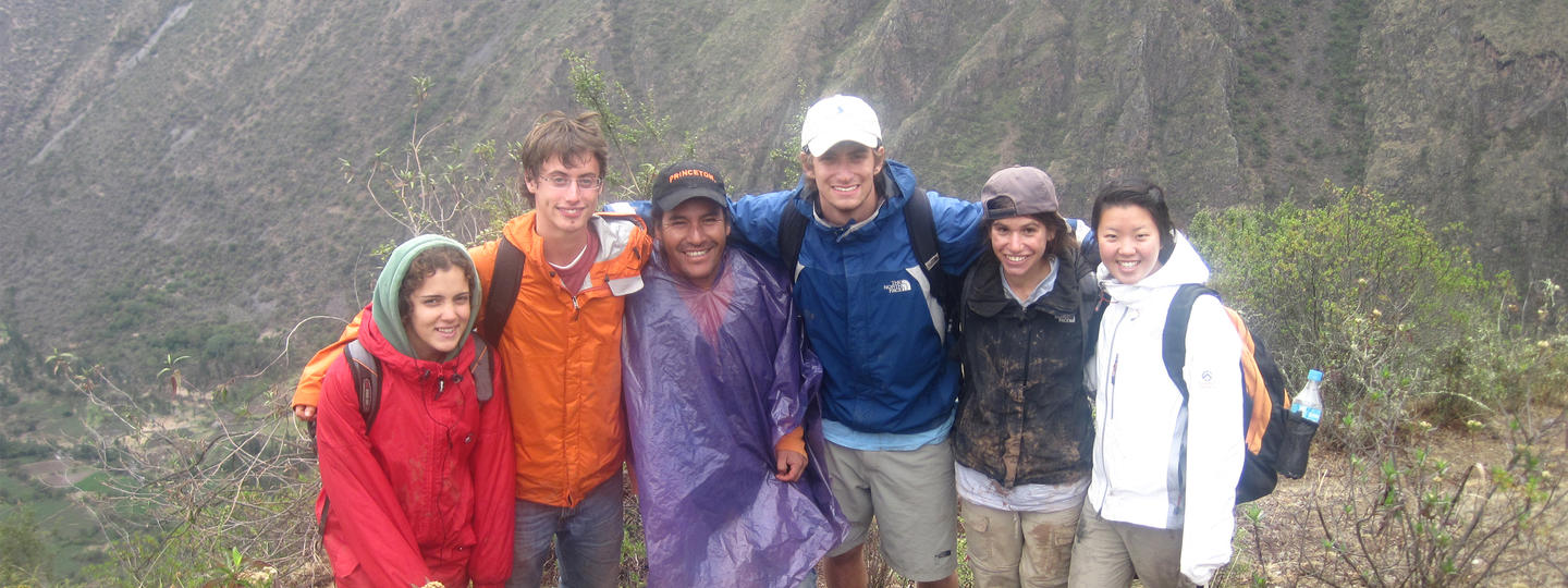 Group of students standing together outside near a mountain