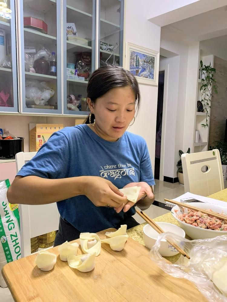 Photo of Lauren Aung filling dumplings